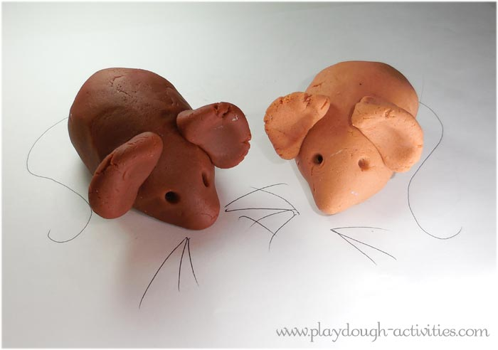 Playdough mice and pen drawn whiskers and tails