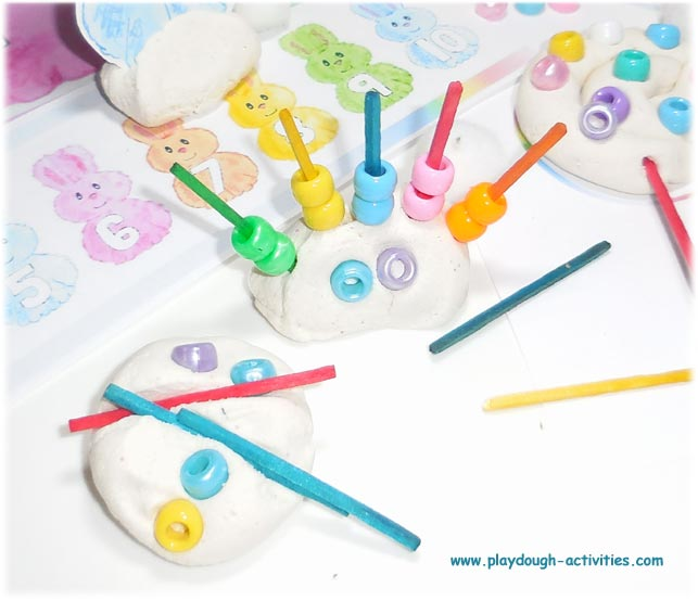 Playdough bead threading activity idea for preschool fine motor skill development