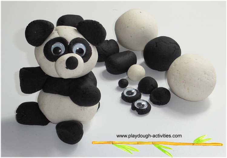 Making a Panda Bear form rolled balls of playdough
