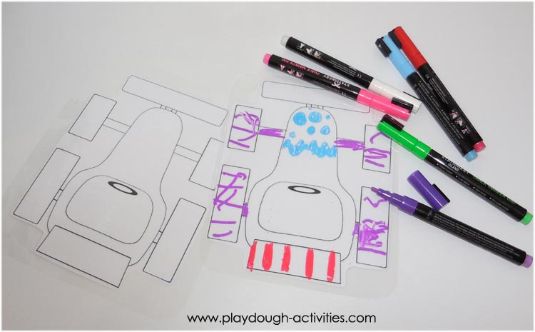 colouring in racing cars with chalk marker pens