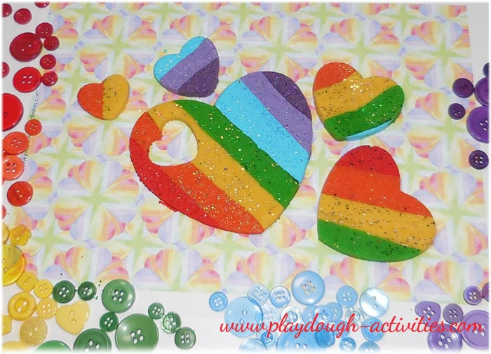 Rainbow coloured heart shaped playdough for Valentines Day activities