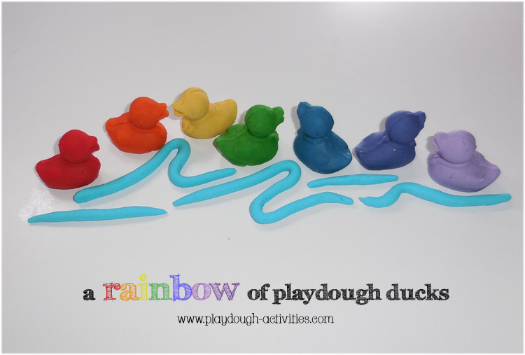 Rainbow playdough ducks with a dash of water ..