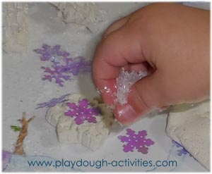 Fine motor skills - pinching and sprinkling artificial snow