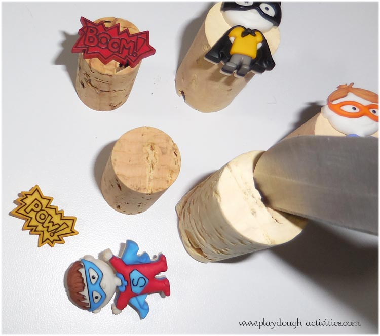 press a groove into the top of the cork to fit the back of the button in place