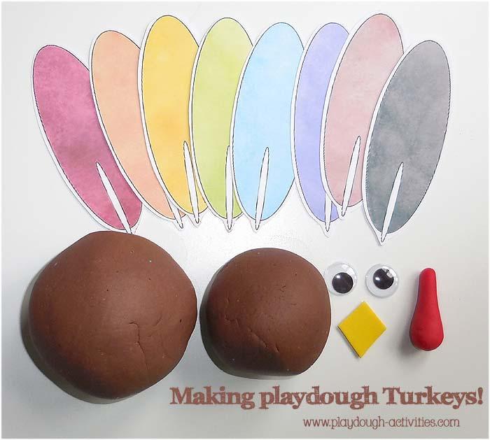 Making Turkey models using playdough, paper feathers, foam beaks and wobbly eyes