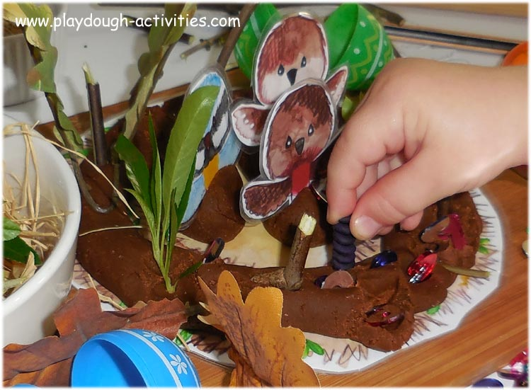 Prod, push and poke in twigs, leaves and sticks into playdough to make bird nests