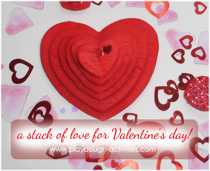 Stacking playdough hearts in a tower of Valentine's day love!