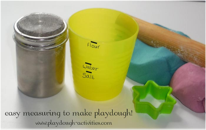 Measuring cup and flour duster to make playdough making easier for kids
