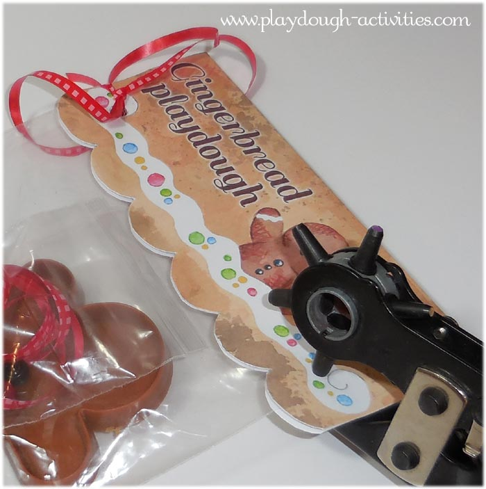 Attach the paper or card gingerbread playdough topper with a hole punch and curling ribbon