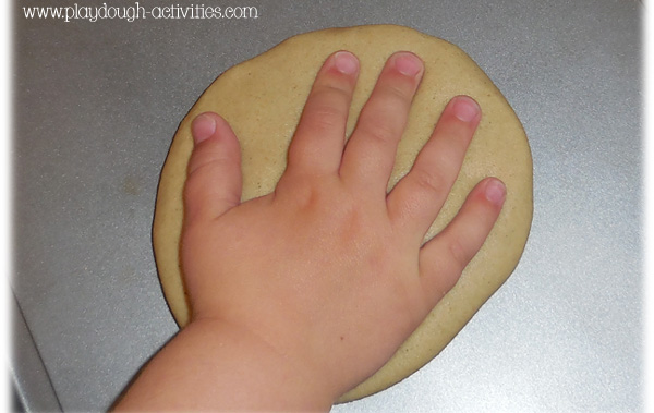 Making hand foot and shape impressions in sand clay