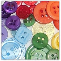 buttons for collaging on the surface of playdough