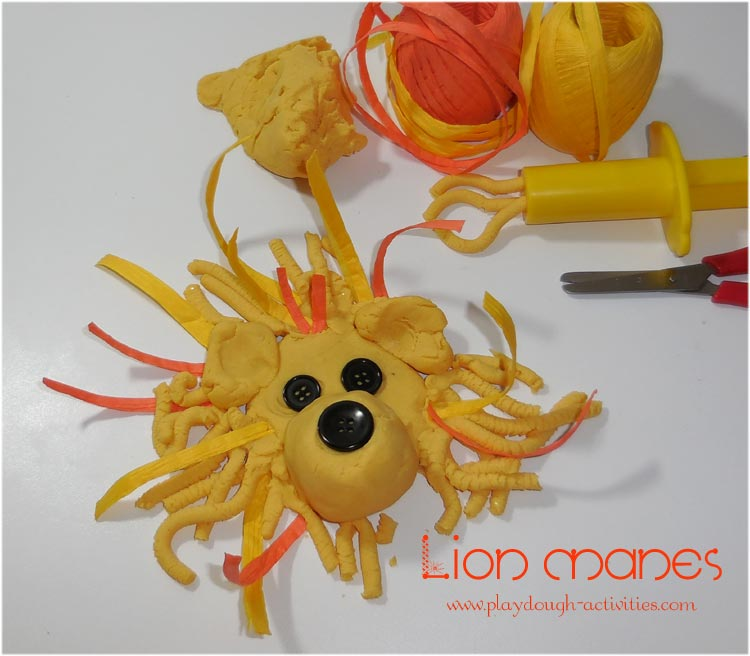Lion mane playdough activity - therapeutic squeezing, cutting and design